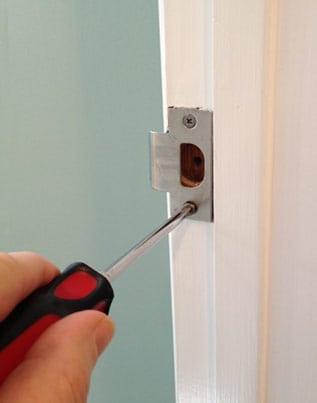 fix loose door strike plate