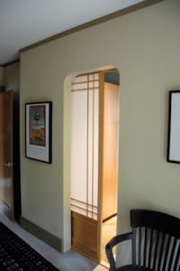 Pocket door with translucent panels glides into the wall for space efficiency.