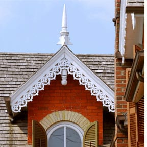 Ornate architectural detailing is fashioned from wood.