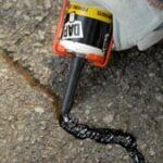 caulking asphalt driveway crack