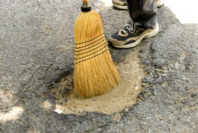 repair asphalt driveway pothole sweep