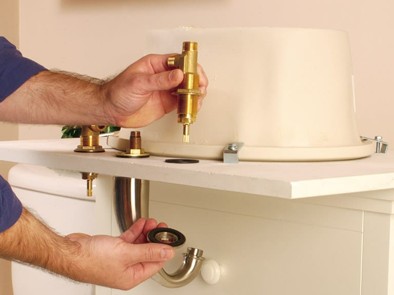 Assemble the faucet body and valve components—ideally, working with the countertop turned upside-down.