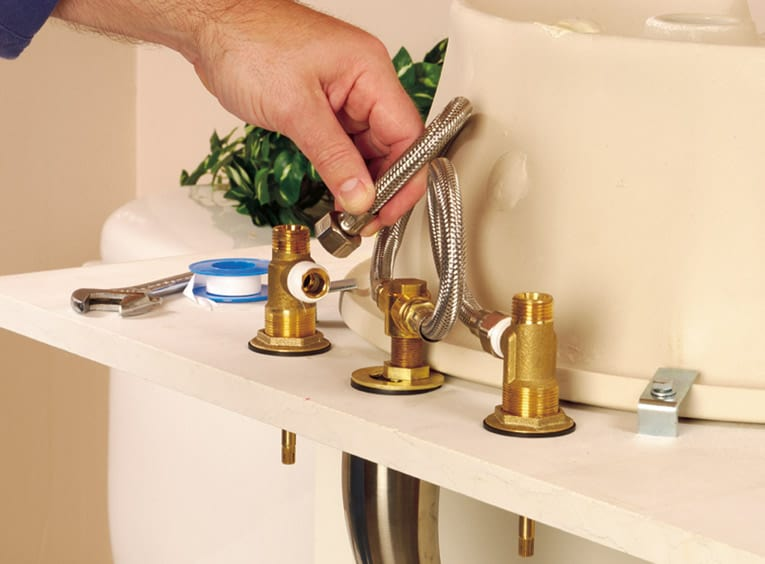 Connect the faucet valves to the faucet body, using flexible tubing.