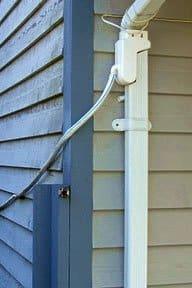 Special downspout attachment diverts rainwater. Photo: Rain Saver