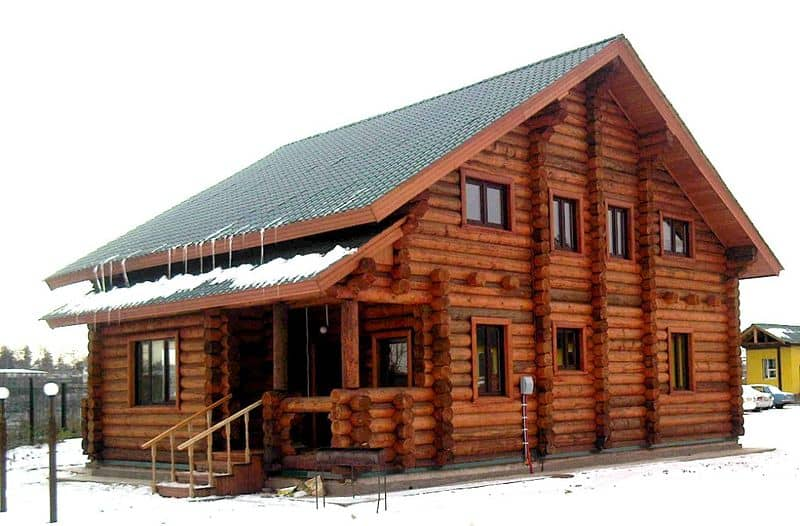 Mountain lodge-style home is built from log construction.