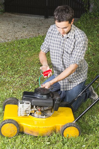 Keeping a well-oiled machine is the key to lawnmower efficiency and safety.  Photo: Dreamstime