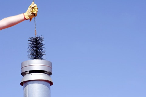 Sweeping a chimney prevents creosote buildup that can cause chimney fires. Photo: Robert Bayer | Dreamstime