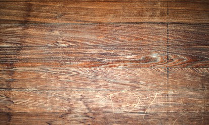 Reclaimed wood floors are loaded with natural character. Photo: Clay Gilpin | Dreamstime
