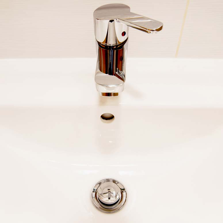 When a pop-up drain stopper doesn't work, the solution usually involves a simple adjustment beneath the sink.