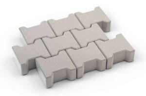 Interlocking concrete pavers form a contiguous surface that resists separations, provides visual interest.