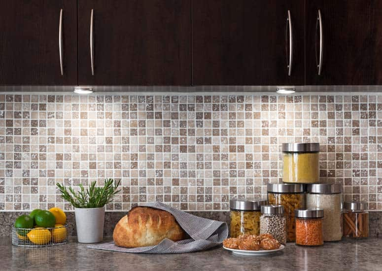 Mosaic tile backsplash provides a stunning, durable wall between countertop and cabinets.