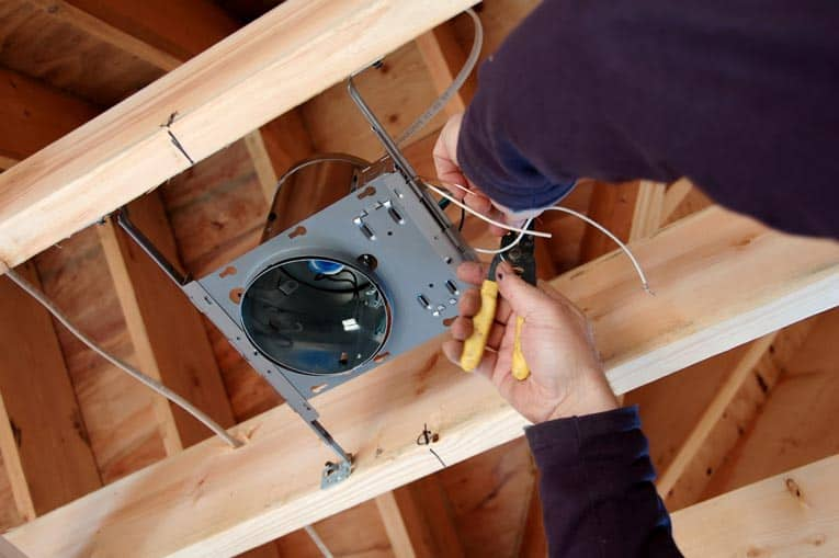 In new construction, recessed lighting is easy to install because the housing is mounted with nail-on flanges.