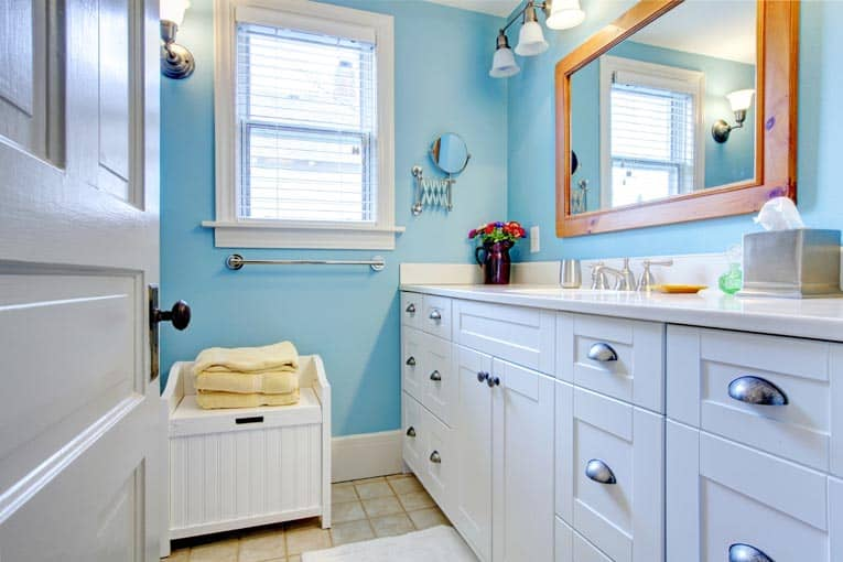 White painted cabinets are cheerful—and a great way to stretch remodeling dollars.
