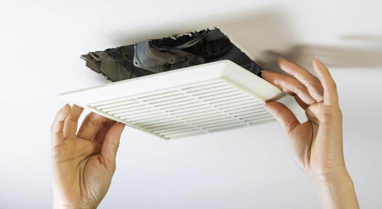 The workings of most bathroom fans are accessed by pulling down the spring-loaded cover.