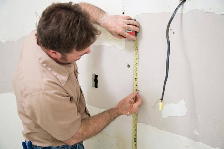 Measure up from your baseline to determine the location of the upper cabinets.