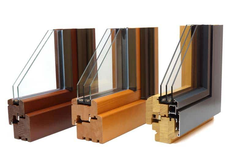 Dual and triple glazed windows provide excellent energy performance. The two windows on the left are solid wood; the frame on the right is wood inside and aluminum clad outside.