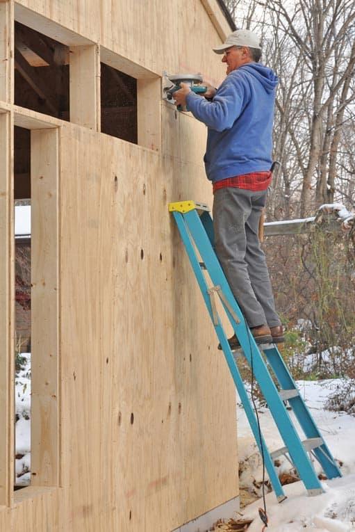 Plywood sheathing provides a sound, flat base for lap siding.