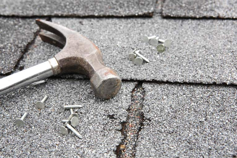 You can tack down curled corners and use roofing cement to seal minor damage, but serious problems call for replacement.