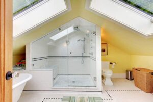 Second floor bathroom is bright and airy, thanks to two skylights.