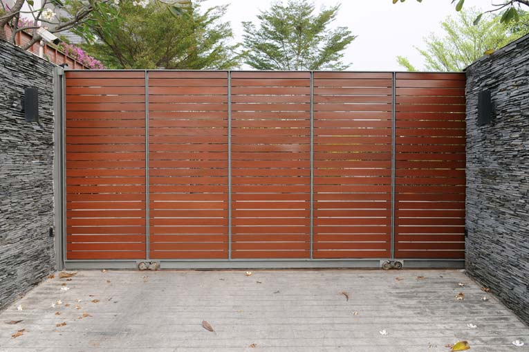Security and privacy are maximized with this steel and wood gate.