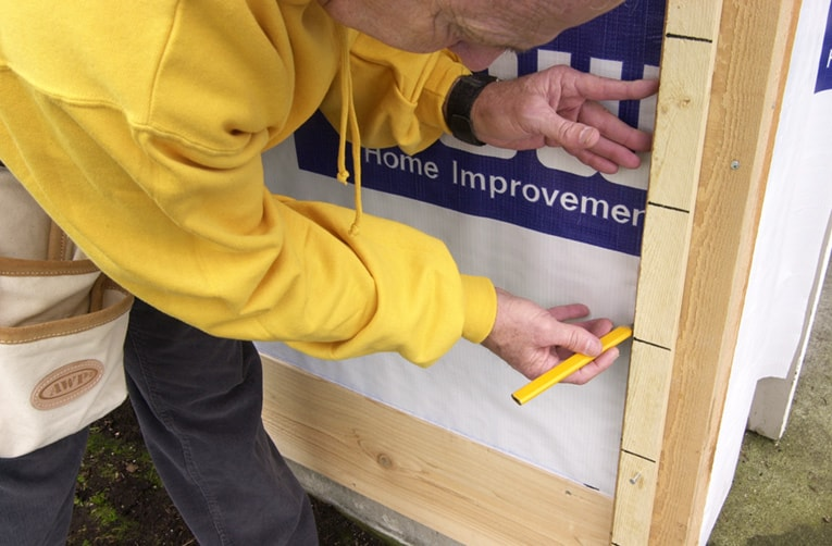 Create and use a story pole to transfer marks for each siding board at the corners.