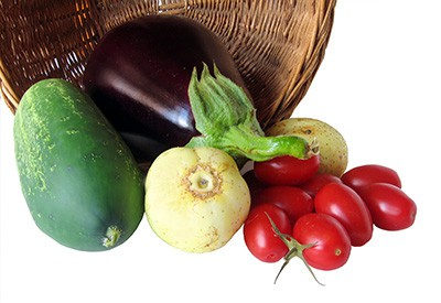 basket of vegetables, including squash eggplant, and radishes
