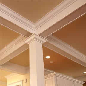 coffered ceiling moldings and post inside a room