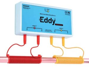 Eddy electronic descaler unit connected to two red and yellow wires that are coiled around the pipe.