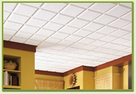 A suspended ceiling of white acoustic panels.