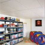 A white suspended ceiling with metal grids on a child's playroom.