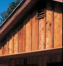 Wooden board-and-batten siding on a gable wall.