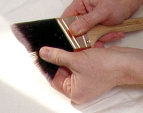 checking bristles of a paint brush
