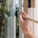 painting window with sash brush