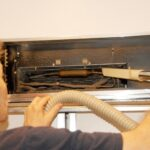 vacuuming refrigerator coils