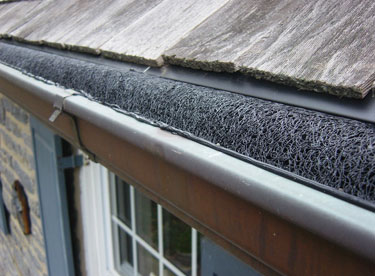 A fitted black UV-protected nylon gutter guard tucked inside.