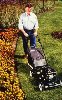 Mowing properly encourages a healthy lawn. Photo: Sears
