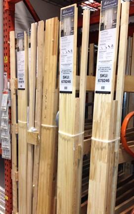 Wooden pocket door frames arranged vertically.