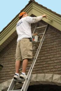 painting exterior house trim with brush
