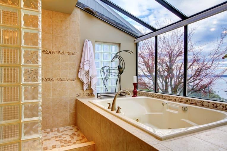 Drop-in bathtub mounts in a step-up platform.