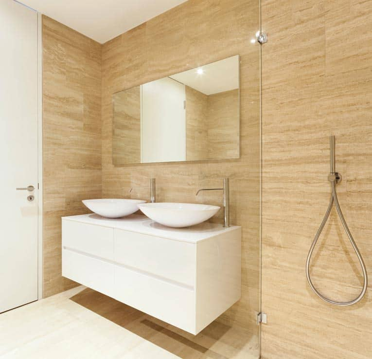 European-style frameless bath cabinet has flush doors with hidden hinges.