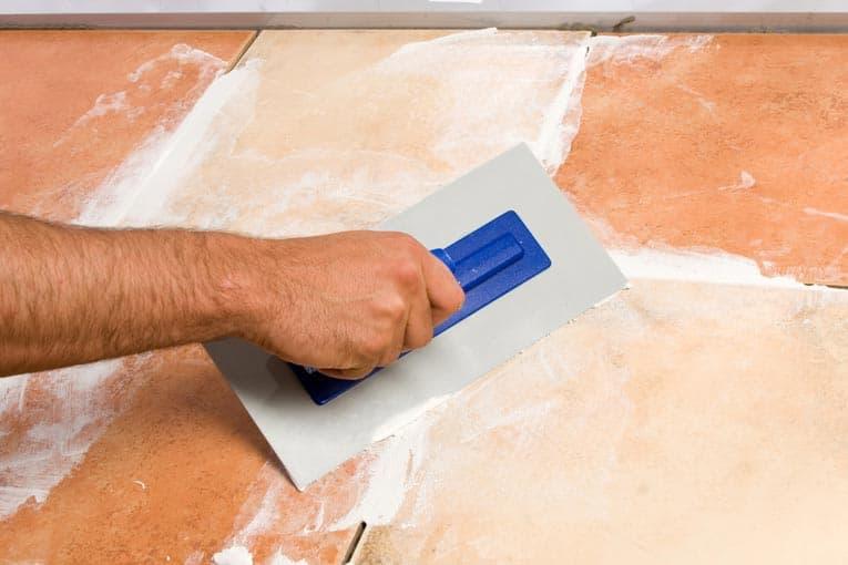 grouting floor tile