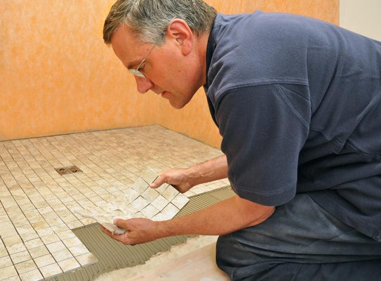 Manufactured mosaic tiles come in sheets, mounted to a web backing.
