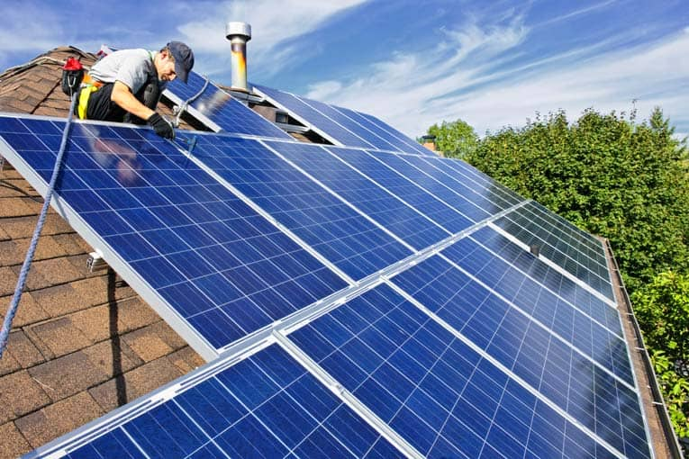 A large array of south-facing photovoltaic solar panels provides significant electricity for this home.